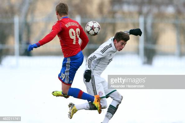 LucasJulian Scholl of Bayern Muenchen battles for the ball with Maksim Martusevic of Moscow during the UEFA Youth League match between CSKA MOscow...