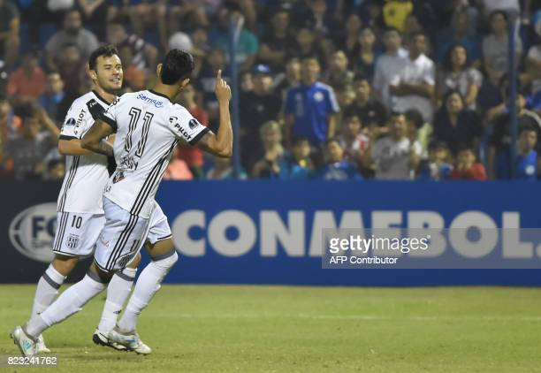 Lucca of Brazil's Ponte Preta celebrates with a teammate after scoring against Paraguay's Sol de America during a 2017 Copa Sudamericana football...