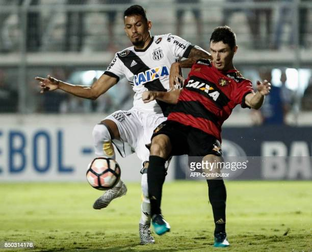 Lucca of Brazils Ponte Preta vies for the ball with Raul Prata of Brazils Sport Recife during their 2017 Sudamericana Cup football match at the...