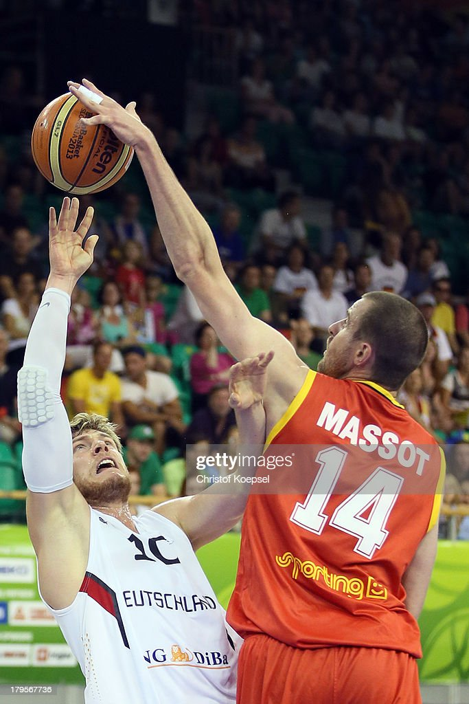 Lucca Staiger of Gemany shoots over Sach Massot of Belgium during the FIBA European Championships 2013 first round group A match between Germany and Belgium at Tivoli Arena on September 5, 2013 in Ljubljana, Slovenia.