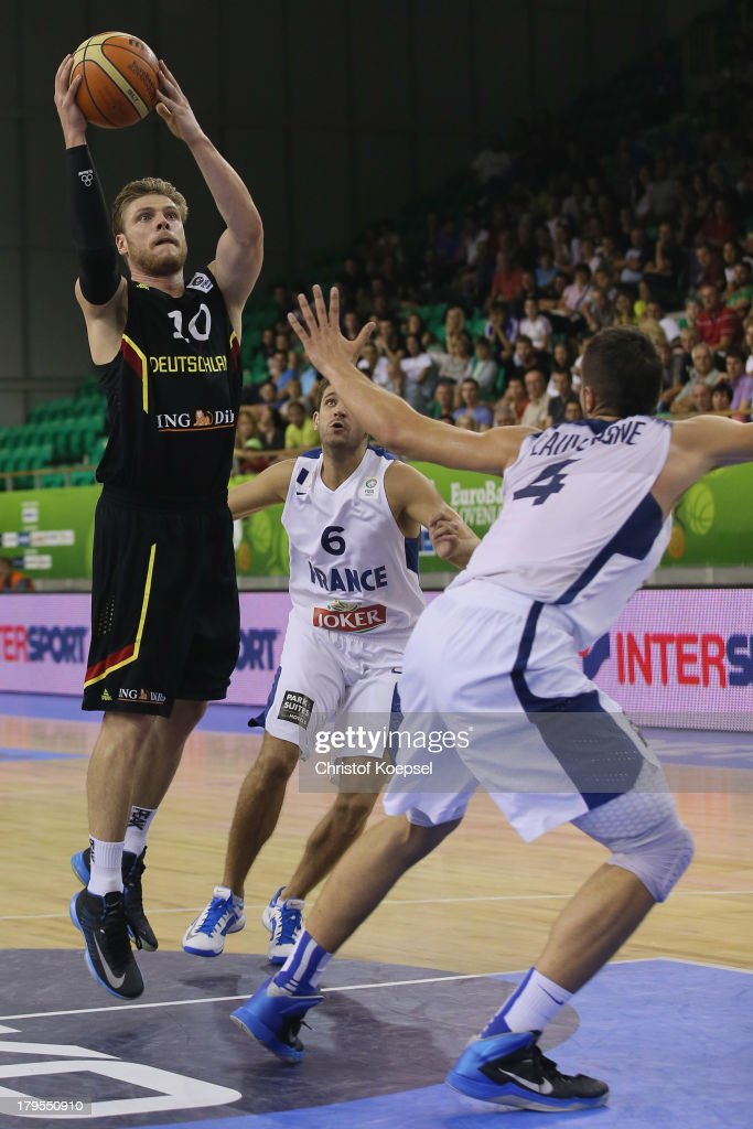 Lucca Staiger of Gemany (L) thorws the ball during the FIBA European Championships 2013 first round group A match between France and Germany at Tivoli Arena on September 4, 2013 in Ljubljana, Slovenia.