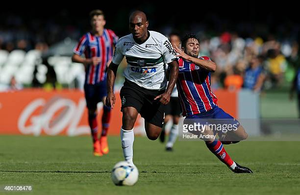 Luccas Claro of Coritiba competes for the ball with Henrique of Bahia during the match between Coritiba and Bahia for the Brazilian Series A 2014 at...