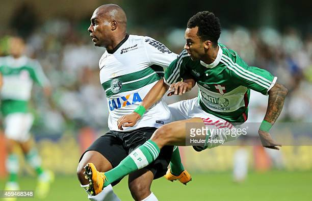 Luccas Claro of Coritiba competes for the ball with Wesley of Palmeiras during the match between Coritiba and Palmeiras for the Brazilian Series A...