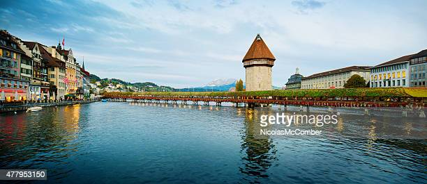 Lucerne Chapel Bridge and Reuss river panorama at sunset Switzerland