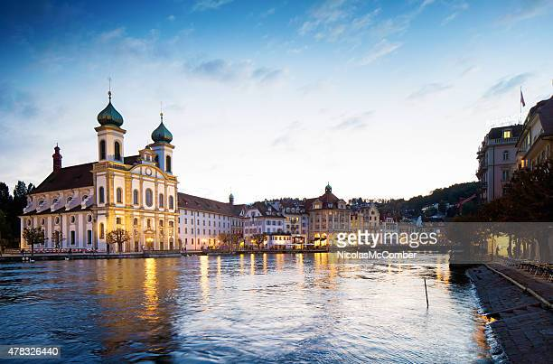 Lucerne Switzerland Reuss river south shore sunset with Jesuit Church