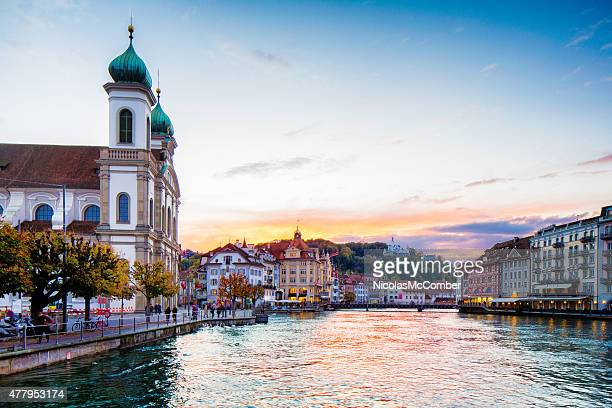 Lucerne Switzerland Reuss river with Jesuit church at sunset Autumn