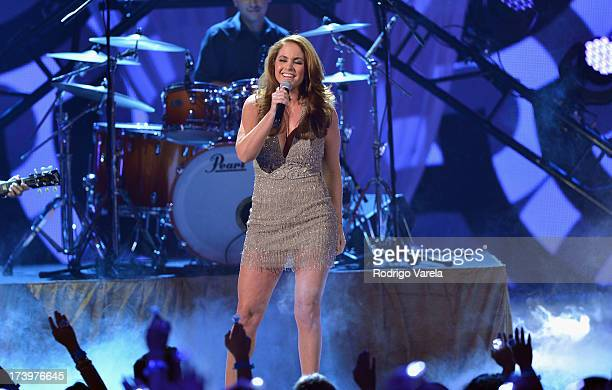 Lucero performs onstage during the Premios Juventud 2013 at Bank United Center on July 18 2013 in Miami Florida