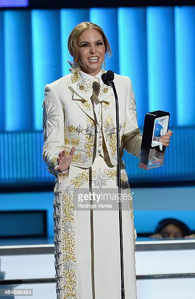 Lucero receives an award onstage at Telemundo's 'Premios Tu Mundo' Awards 2015 at American Airlines Arena on August 20 2015 in Miami Florida