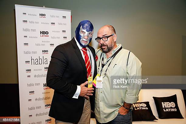 Luchador Blue Demon Jr and director Alberto Ferreras pose for a photograph during HBO Latino Habla Men at People en Español San Antonio Festival at...