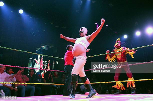 Luchadores Dirty Sanchez and Crazy Chickens perform at Luca VaVOOM Valentine's Show 'Dangerous/Beautiful' at The Mayan on February 11 2015 in Los...