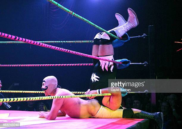 Luchadores Dirty Sanchez and DrMaldad perform at Luca VaVOOM Valentine's Show 'Dangerous/Beautiful' at The Mayan on February 11 2015 in Los Angeles...