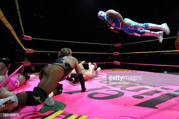 Luchadores perform acrobatic fighting moves at the Lucha Vavoom Noche de los Salvajes Halloween show at the Mayan Theater on October 30 2013 in Los...
