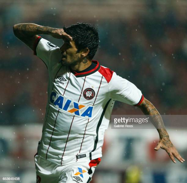 Lucho Gonzalez of Atletico Paranaense celebrates after scoring the first goal of his team during a group stage match between San Lorenzo and Atletico...