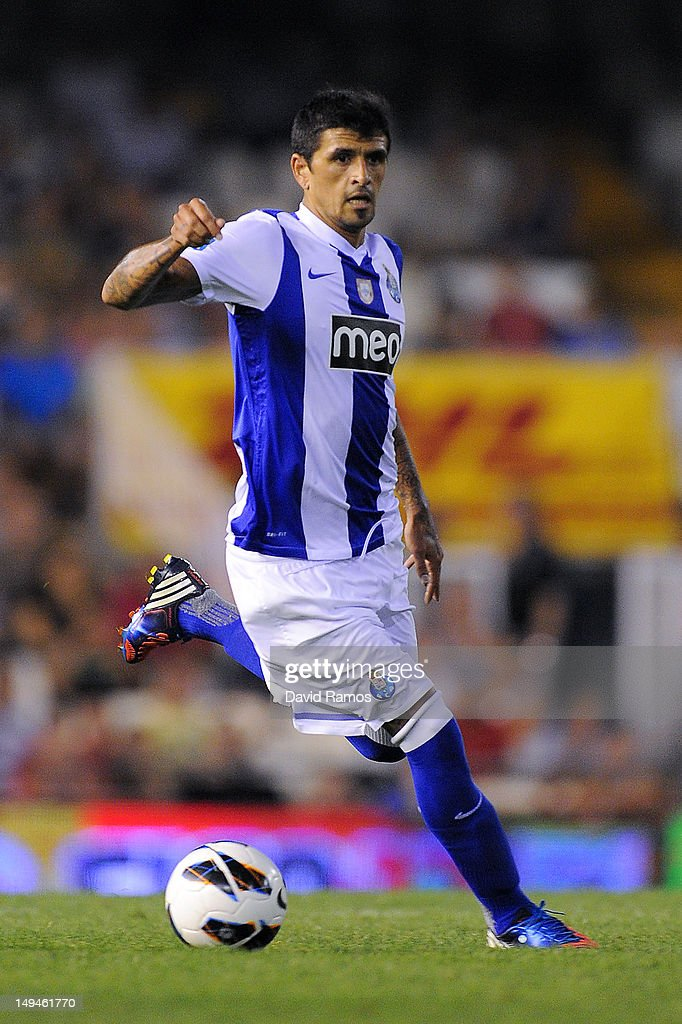 Lucho Gonzalez of FC Porto runs with the ball during a PreSeason friendly match between Valencia CF and FC Porto at Estadio Mestalla on July 28 2012...