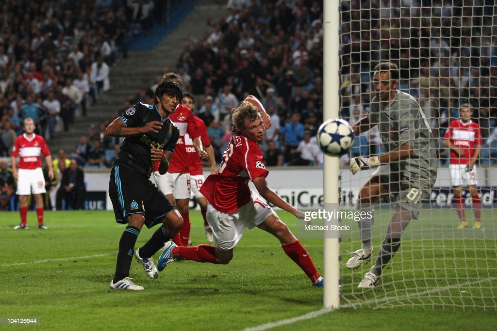 Lucho Gonzalez (l) of Marseille heads narrowly wide during the UEFA Champions League Group F match between Olympique Marseille and Spartak Moscow at the Stade Velodrome on September 15, 2010 in Marseille, France.