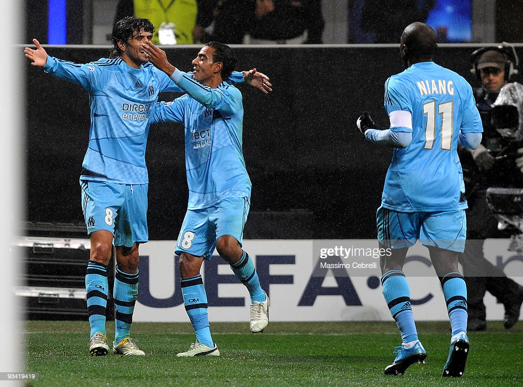 Lucho Gonzalez of Olympique de Marseille celebrates his first goal with his team mates during the UEFA Champions League Group C match between AC Milan and Olympique de Marseille on November 25, 2009 in Milan, Italy.