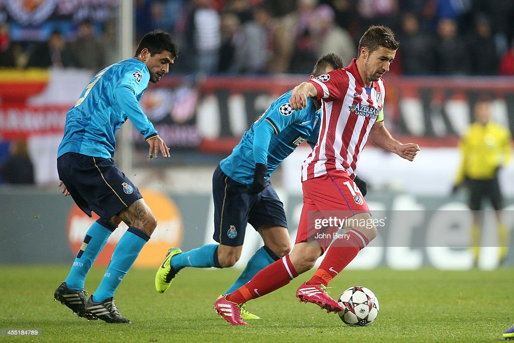 Lucho Gonzalez of Porto and Gabi Fernandez of Atletico in action during the UEFA Champions League match between Atletico de Madrid and FC Porto at...