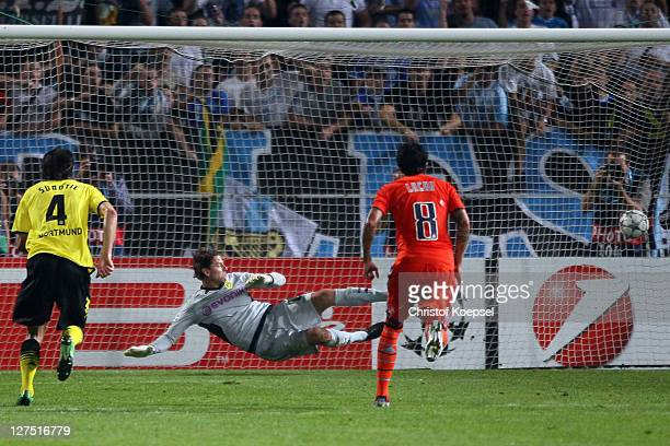 Lucho González of Olympique Marseille scores by penalty against Roman Weidenfeller of Dortmund during the UEFA Champions League group F match between...
