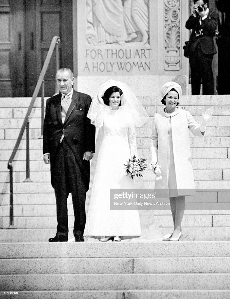 Luci Baines Johnson flanked by President Lyndon Johnson and Lady Bird Johnson on steps of Immaculate Conception Cathedral before her wedding.