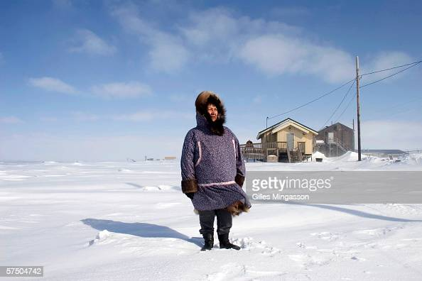 Luci Eningowuk an Inupiat Eskimo and Chaiwoman of Shishnaref's Relocation Commitee stands on the frozen Chukchi Sea near the shore of Sarichef island...