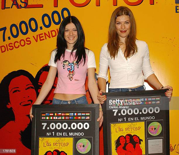 Lucia and Pilar of music group Las Ketchup smile as they receive triple platinum disc January 29 2003 in Madrid Spain