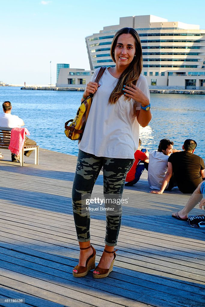 Lucia Andres from Spain seen wearing a H&M's T-shirt, camouflage pants bought in Australia, 'esparto wedges shoes' from Hernandez Shoes Store and Hazel's handbag on June 25, 2014 in Barcelona, Spain.
