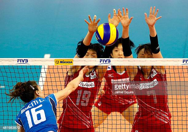 Lucia Bosetti of Italy spikes the ball as Haruka Miyashita Mai Yamaguchi and Chizuru Koto of Japan defend during day 4 of the FIVB Volleyball World...