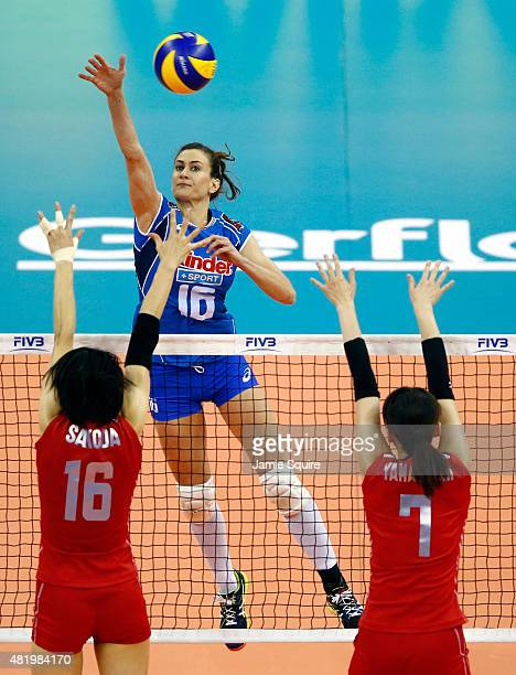 Lucia Bosetti of Italy spikes the ball as Saori Sakoda and Mai Yamaguchi of Japan defend during day 4 of the FIVB Volleyball World Grand Prix on July...