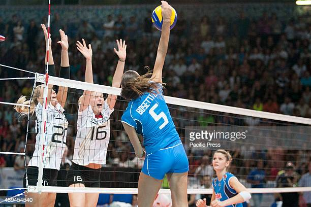 Lucia Bossetti scores a point against Mareen Apitz and Anja Brandt during women's volleyball match played between Italy and Germany