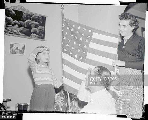 Lucia Giampaolo looking forward to her first American Christmas was given a lesson in citizenship by her foster parents Arduino center and Anna...