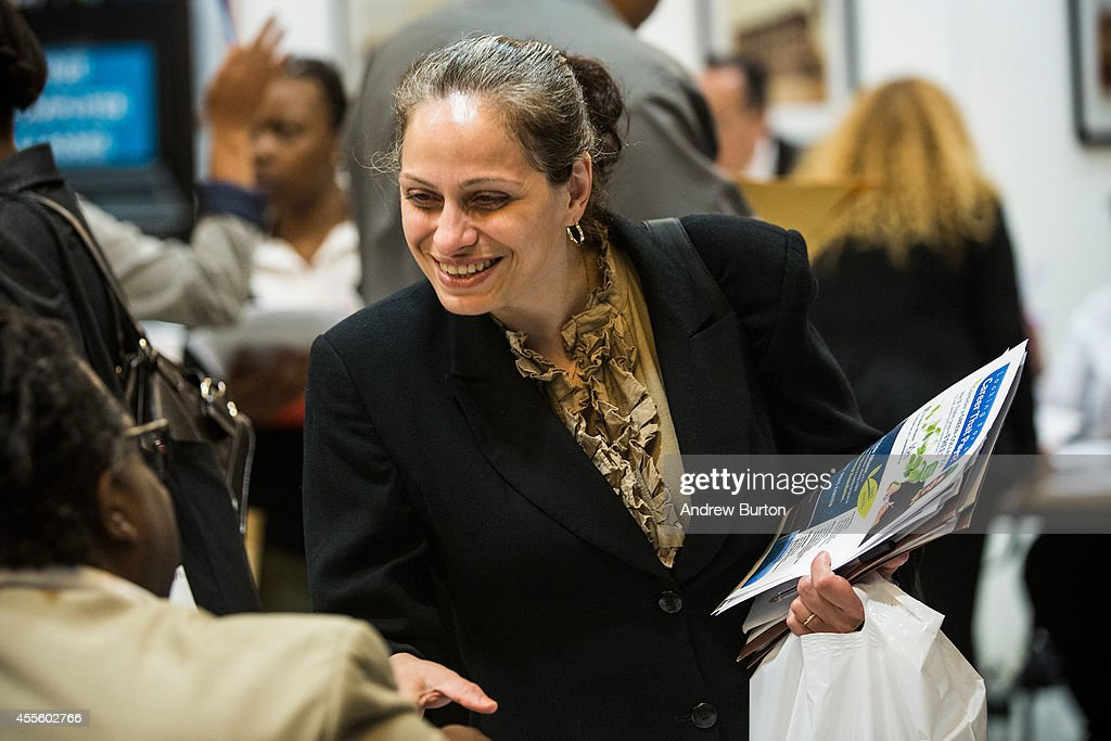 Lucia Imparato meets with a job recruiter at a jobs fair at the Bronx Public Library on September 17 2014 in the Bronx Borough of New York City...