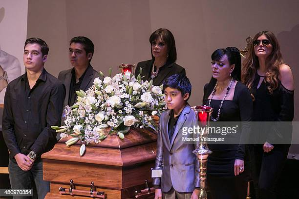 Lucia Mendez Ana Barbara and Maribel Guardia stand guard by the coffin of Joan Sebastian during a funeral ceremony organized by Sociedad de Autores y...