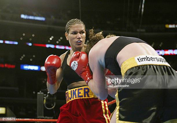 Lucia Rijker hits Jane Couch during their women's light welterweight bout at the Staples Center on June 21 2003 in Los Angeles California Lucia...
