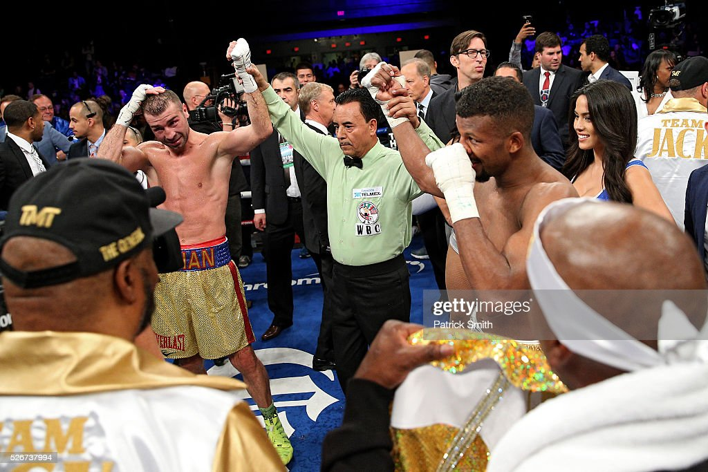 Lucian Bute of Canada (left) and Badou Jack of Sweden react after a draw was called after 12 rounds in their WBC super middleweight championship bout at the DC Armory on April 30, 2016 in Washington, DC.