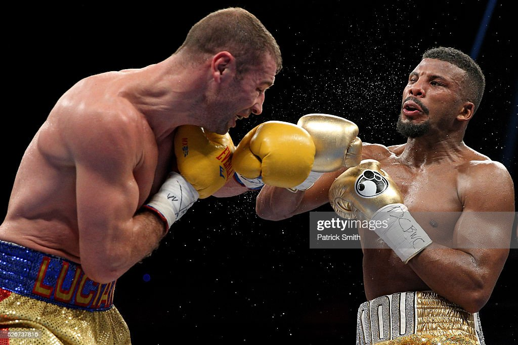 Lucian Bute of Canada (left) exchanges punches with Badou Jack of Sweden in their WBC super middleweight championship bout at the DC Armory on April 30, 2016 in Washington, DC.