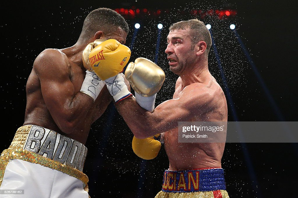 Lucian Bute of Canada (right) exchanges punches with Badou Jack of Sweden in their WBC super middleweight championship bout at the DC Armory on April 30, 2016 in Washington, DC.