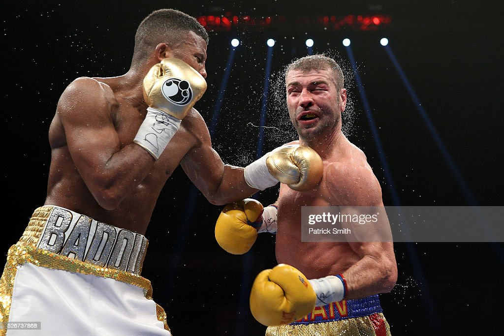 Lucian Bute of Canada (right) is punched by Badou Jack of Sweden in their WBC super middleweight championship bout at the DC Armory on April 30, 2016 in Washington, DC.