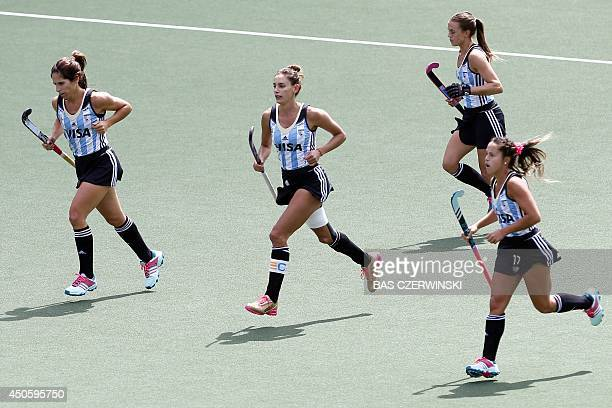 Luciana Aymar of Argentina celebrates her goal with her teammates during the Field Hockey World Cup women's tournament match between the USA and...