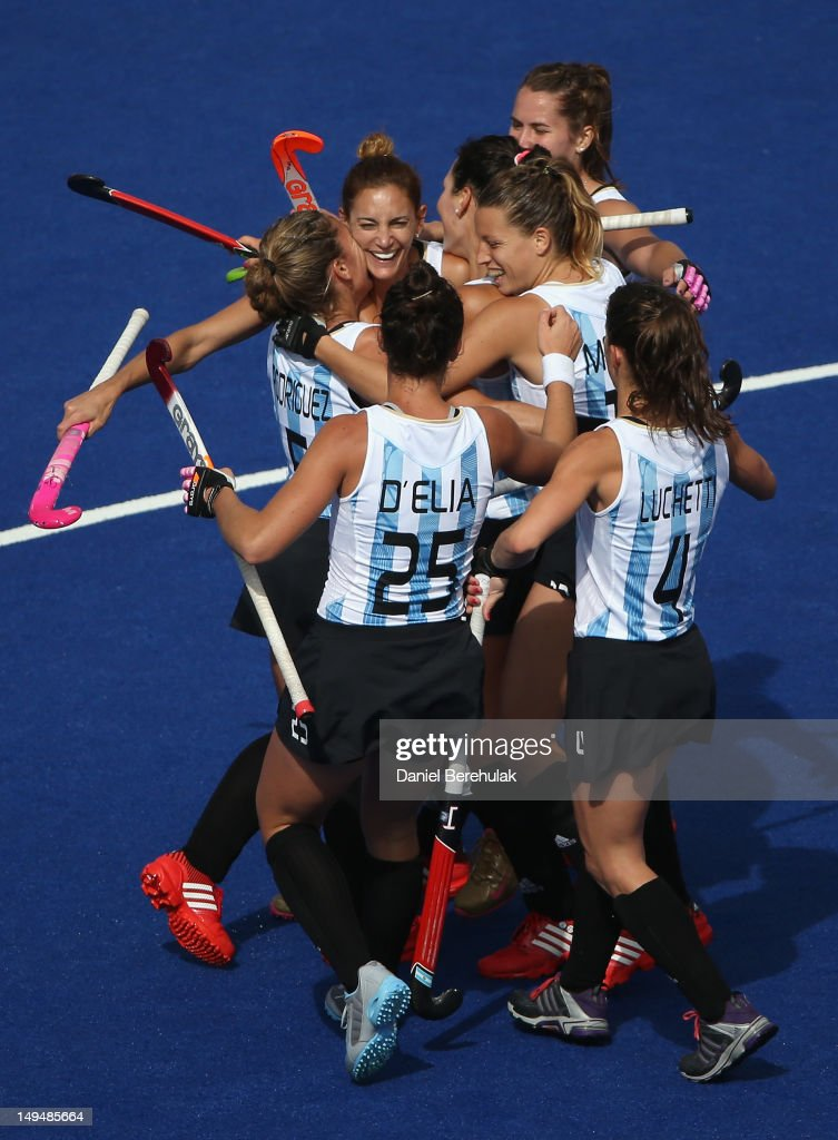 <a gi-track='captionPersonalityLinkClicked' href=/galleries/search?phrase=Luciana+Aymar&family=editorial&specificpeople=760605 ng-click='$event.stopPropagation()'>Luciana Aymar</a> of Argentina celebrates scoring her team's fourth goal with her team mates during the Women's Pool WB Match W04 between Argentina and South Africa at the Hockey Centre on July 29, 2012 in London, England.