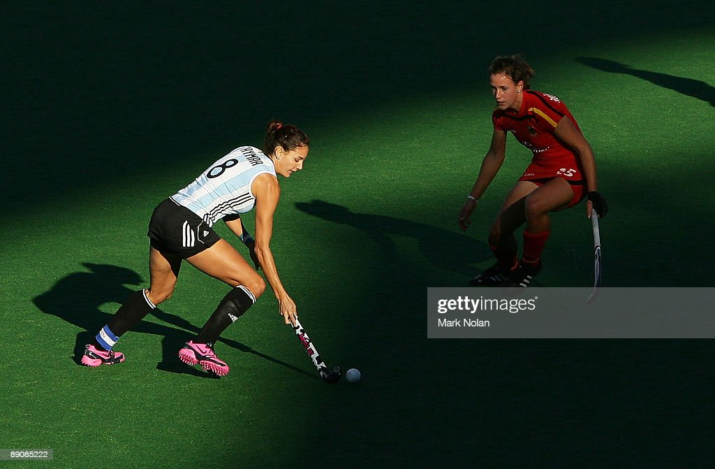 Luciana Aymar of Argentina takes on the defence during the Women's Hockey Champions Trophy match between Argentina and Germany at Sydney Olympic Park...