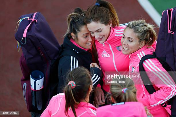 Luciana Aymar of Las Leonas talks with her teammates after a press conference to announce modifications in the support staff of new coach Santiago...