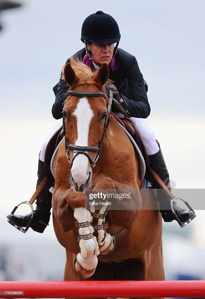Luciana Diniz of Portugal on Fit For Fun 13 on their way to 3rd place during the Longines Global Champions Tour of London on Day Four at Olympic Park on June 9, 2013 in London, England.