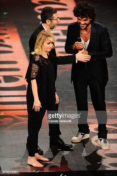 Luciana Littizzetto Francesco Renga and Fabio Fazio attend fourth night of the 64th Festival di Sanremo 2014 at Teatro Ariston on February 21 2014 in...