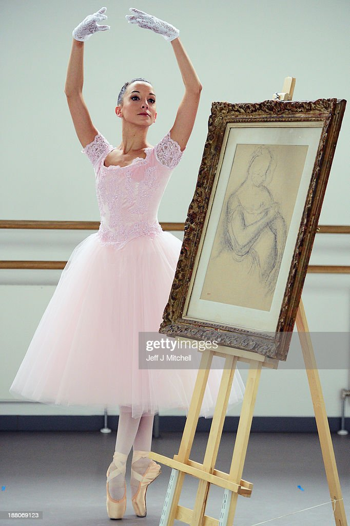 Luciana Ravizzi, in her dream dress from Scottish Ballet's forthcoming premiere of Hansel & Gretel, stands next to a sketch of a ballerina by Edgar Degas, entitled 'Danseuse Rajustant L'Epaulette de Son Corsage' on November 15, 2013 in Glasgow, Scotland. The sketch is to be sold at Lyon and Turnbull fine paintings sale on the November 28, 2013. It is valued at £80,000-120,000 and is part of a collection of paintings belonging to Manchester born Albert Davis.