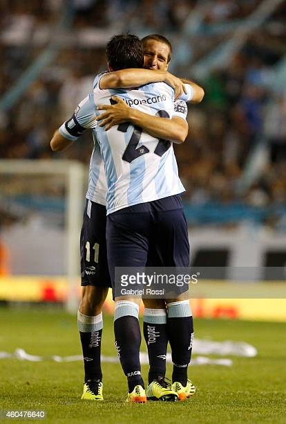Luciano Aued and Diego Milito of Racing Club celebrate after Ricardo Centurion scored the opening goal during a match between Racing Club and Godoy...
