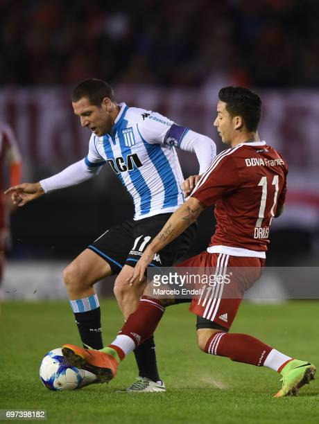 Luciano Aued of Racing Club fights for the ball with Sebastian Driussi of River Plate during a match between River Plate and Racing Club as part of...