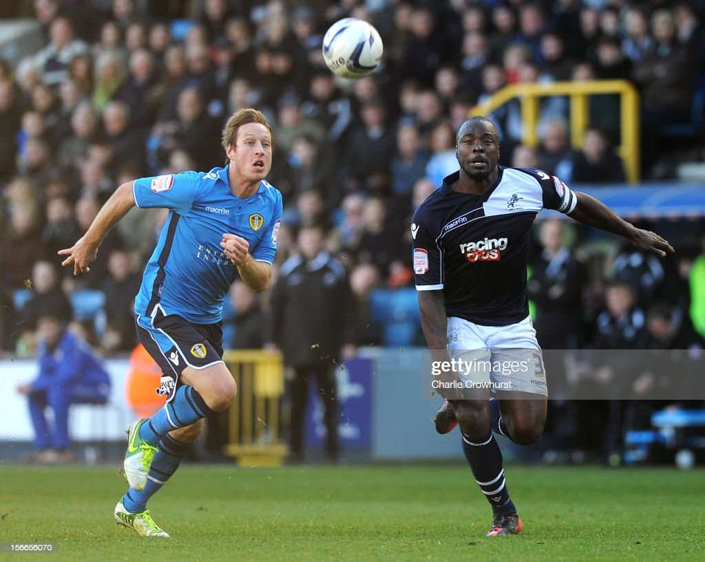 Luciano Becchio (L) of Leeds chases the ball with Danny Shittu of Millwall during the npower Championship match between Millwall and Leeds United at The New Den on November 18, 2012 in London, England.