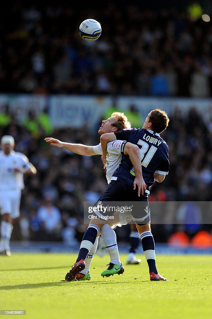 <a gi-track='captionPersonalityLinkClicked' href=/galleries/search?phrase=Luciano+Becchio&family=editorial&specificpeople=5489468 ng-click='$event.stopPropagation()'>Luciano Becchio</a> (left) of Leeds <a gi-track='captionPersonalityLinkClicked' href=/galleries/search?phrase=Shane+Lowry+-+Soccer+Player&family=editorial&specificpeople=12866006 ng-click='$event.stopPropagation()'>Shane Lowry</a> of Millwalll battle for the ball during the npower Championship match between Leeds United and Millwall at Elland Road on December 03, 2011 in Leeds, England.