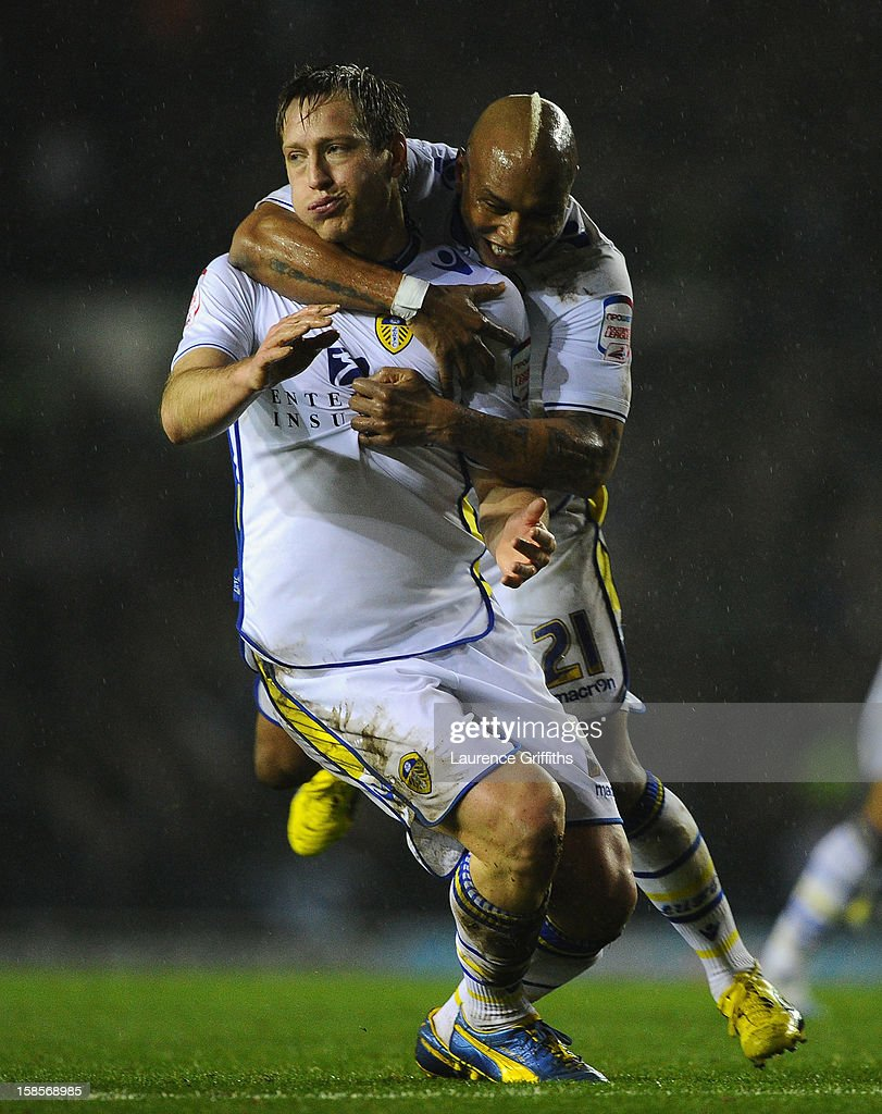 Luciano Becchio of Leeds United celebrates scoring the opening goal with team-mate El-Hadji Diouf (R) during the Capital One Cup Quarter-Final match between Leeds United and Chelsea at Elland Road on December 19, 2012 in Leeds, England.