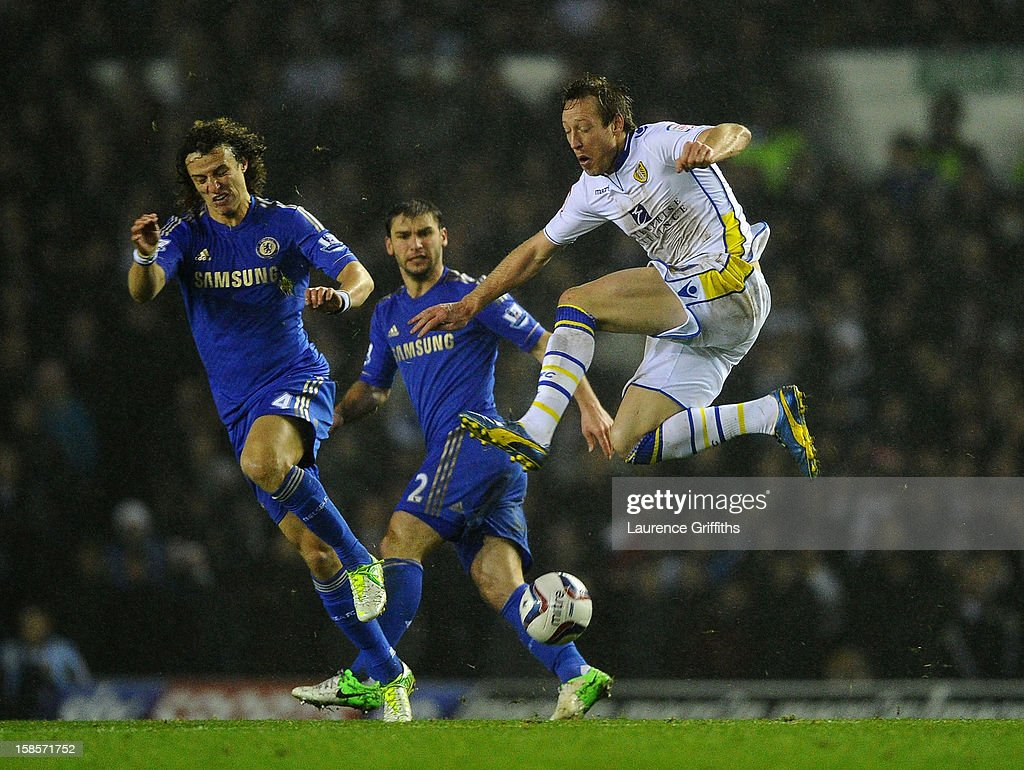Luciano Becchio of Leeds United competes with David Luiz of Chelsea during the Capital One Cup Quarter-Final match between Leeds United and Chelsea at Elland Road on December 19, 2012 in Leeds, England.